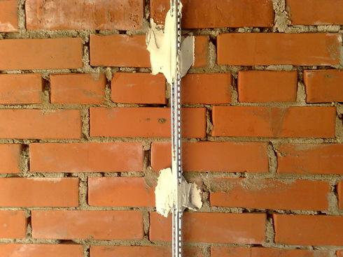 Механизированная штукатурка стен по маякам
